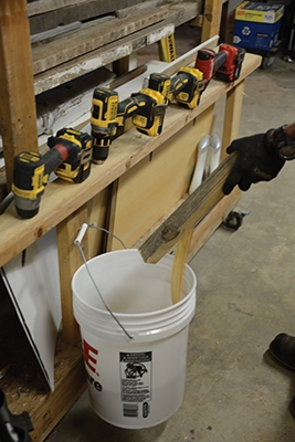 Placing the cut-offs bucket right behind where I'm cutting means I can almost effortlessly manage cut-offs and stuff that tend to litter shop floor.