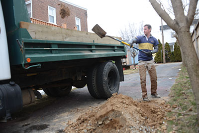Dumpster companies where I live do not like concrete and dirt in their boxes. you might think about a dump truck rental, friend, landscaper or other means of getting rid of reno dirt.