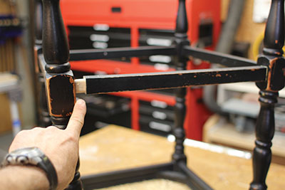 Spread the legs to expose the tenon of the stretcher.