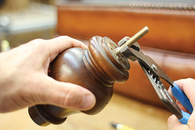 Screw in the dual fastener which should thread tightly into the hole.