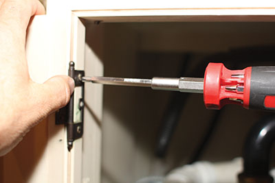 Reinstall the screw, which should fasten snugly into the smaller hole.
