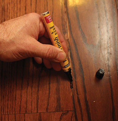 A wood stain marker is an easy way to conceal scratches in furniture and hardwood flooring.