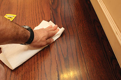Simply apply a matching stain to the scratch and wipe away the excess to make little dings