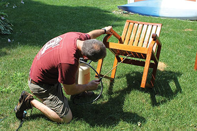 Apply the cleaning solution to the entire furniture item.