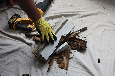 Remove and dispose of all rotted wood, including casing and/or brick molding.