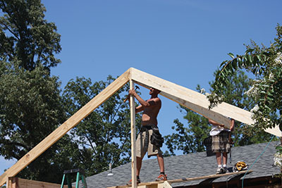 Temporary support braces are used to keep framing components in place while the roof-build continues.