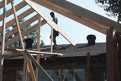 The new ridge will tie into the existing roof as a hip-and-valley offshoot.