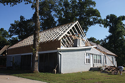 The extra height gained from the new roof allows room for a gable window vent on the front of the home.