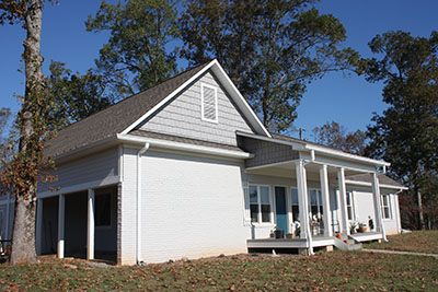 Shown is the completed project with siding, paint and trim.
