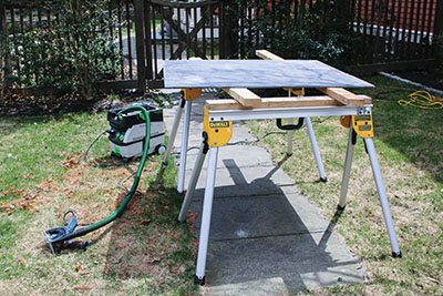 Place the slate on a sturdy work surface and make sure to support the area directly underneath the cut line.
