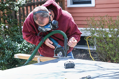 Cut the slate with a grinder or circular saw equipped with a diamond blade.