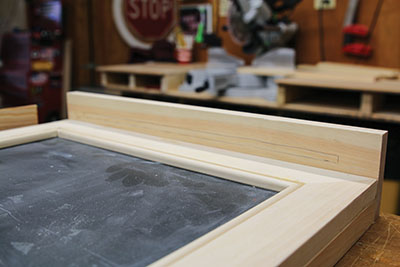 Align the chalkboard shelf and mark the position of the chalk slot.