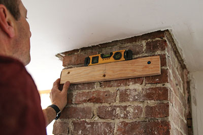 If mounting to a masonry wall,m attach the first concrete screw, level the cleat, the drill for the next screw.