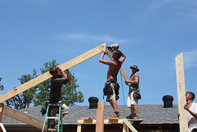 Roofing requires multiple workers to lift heavy materials and make proper connections in all the right spots.