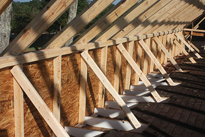 This knee-wall was constructed to raise the eave of the new roof and give the home a taller, grander design.