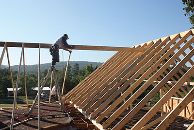 The home's simple gable roof was redesigned as a hip-and-valley roof with multiple ridge lines.