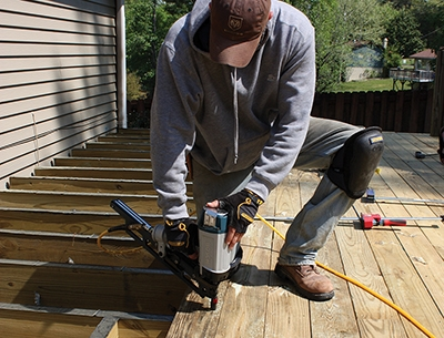 If a deck board is bowed, install it with a crown on top. Gravity combined with the weight of people and furniture will flatten the board and prevent sagging.