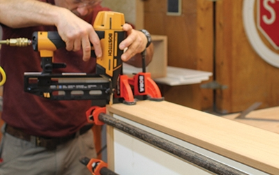 Finish nails help close the corners during glue-up.