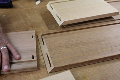 The slots in the corners hold wood biscuits to strengthen the joints.
