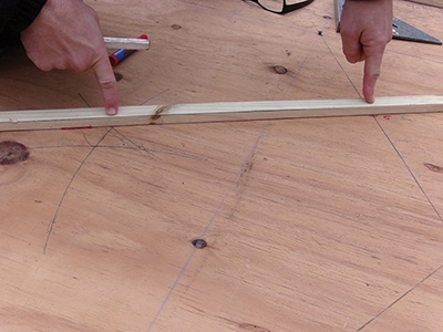 Lines H and I will help determine the pivot point for drawing your final doorway arch.