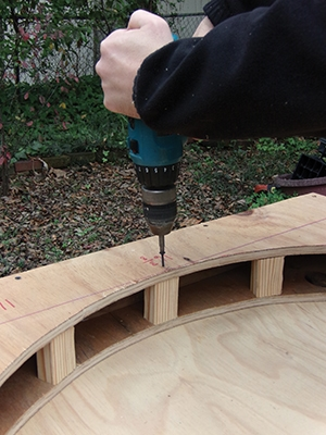 Screw the blocking in place but leave out the end pieces until the archway has been installed.
