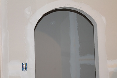 The Doorway Was Then Finished With Joint Compound Primed And Painted