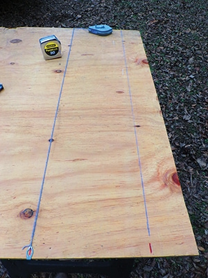 Snap a chalk line between the upper marks and a second parallel line between the lower marks.