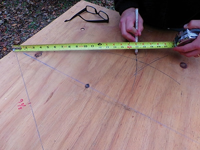 Carefully align your pencil with the tape measure to trace the line.
