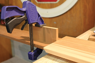 For repetitive production cutting, set stop blocks for the workpieces on your miter saw.