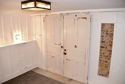 Reclaimed doors and Johnson rolling door hardware combine for a look that works great and is easy to install.
