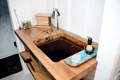 "Here's the completed sink deck (when you make it out of 3x10 lumber, it's not a ""vanity"")."
