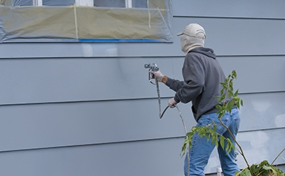 For large projects such as painting house siding, an airless sprayer can speed up the process while achieving a very smooth, even finish.