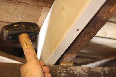 Level the joist before fastening.