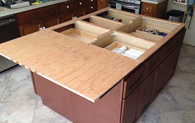 Much of the plywood is cut away to allow the solid surface to dissipate heat or cold to minimize differential expansion and contraction. To be safe, I should have also done this for the overhang section.