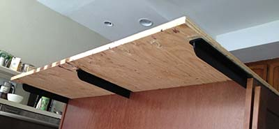 "Counterbalance supports are shown under the plywood. Overhangs greater than 6"" need such additional support. This style support, as opposed to corbels, is less likely to bang knees or get in the way of stools."