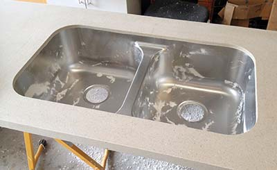 A succesful installation of the sink is simplified by the added solid surface ring applied to the top of the sink by the manufacturer.