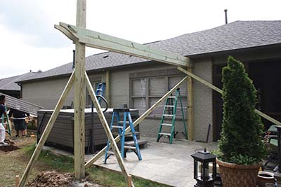 Use 2x4 braces to hold the support structure plumb and square while building the pergola.