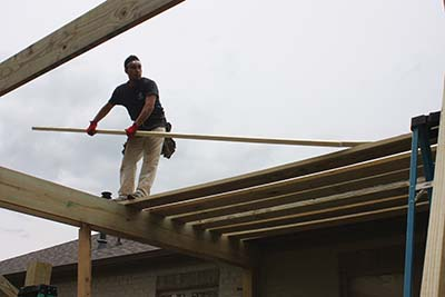 The rafters are made of 2x10 on this project, one size smaller than the 2x12 girders.