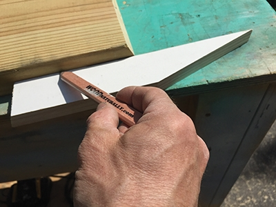 Using a 1x to mark the 2x for the half-miter on shelf material is easier than measuring.