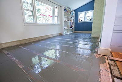 When the leveling compound has cured, install the hardwood flooring according to standard procedures.