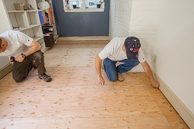 Plan the installation as you would any standard flooring job by snapping lines to guide board placement and accounting for out-of-square walls.