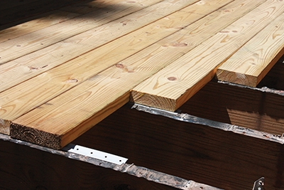 "Inspect the end-grain of the boards and fasten them ""bark side up."""