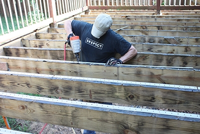 Nail to the tops of the joists.