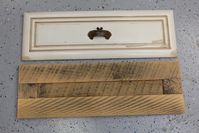 Shown here is a replacement for a drawer front, which exhibits the rough sawn texture the home-owner desired.