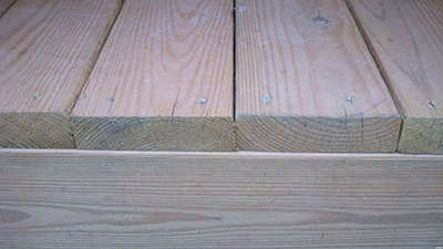 The rule of thumb for installing deck boards: Put the best side up.