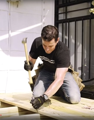 Use a chisel as a lever to persuade deck boards into place. It's simple and works well-along with being a great work out!