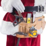 45992349 - father christmas is wearing a tool belt on white background