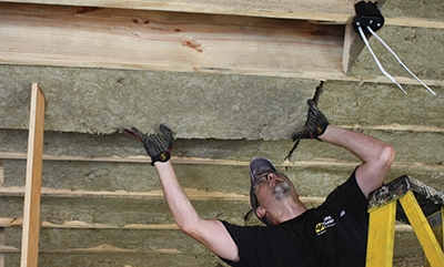 This project entailed insulating both the walls and floor joists of a master bedroom.