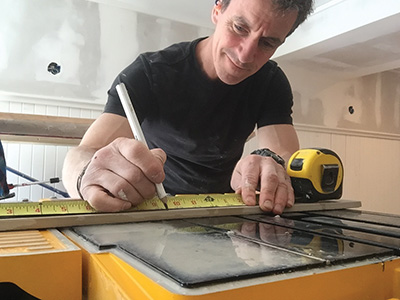 A wet saw is the most versatile tool for cutting tile.