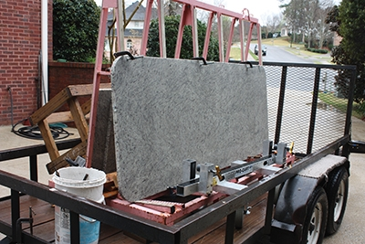 The granite slabs are transported on special racks that reduce vibration on the road.
